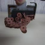 新作ジーンズ S66(TP) リベット表の素材を変更します。ボタンのサビを紹介。